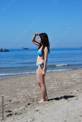 Asian girl in a bikini looking at the horizon2