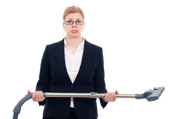 Unhappy businesswoman with vacuum cleaner