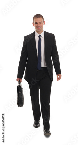 Portrait of a successful young business man carrying a suitcase