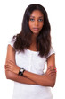 Beautiful young black woman with folded arms
