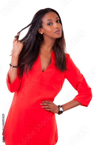 Beautiful young black woman in red dress