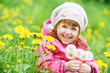 little child girl with spring dandelion