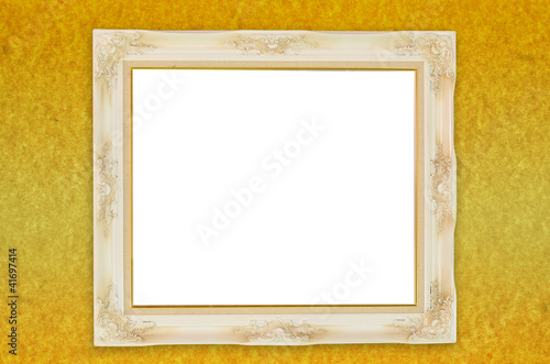 Old antique frame over gold paper background