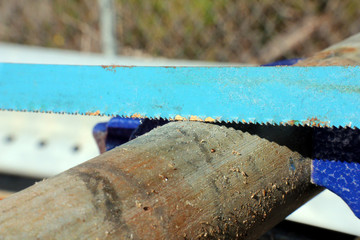 Hacksaw Blade On Uncut Pipe In Vise