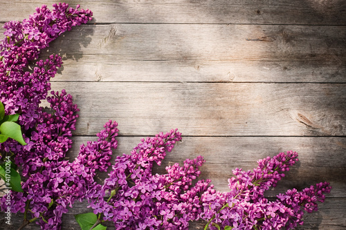 The beautiful lilac on a wooden background|41700264