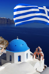 Church in Satorini with Greek flag and sea-view