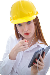 Young beautiful female with yellow helmet using a cellphone