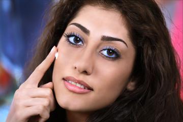 Applying night cream pretty girl face closeup