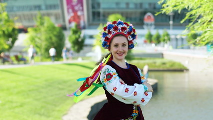 Ukrainian girl on the background of Donbass Arena. Euro-2012.