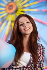 Smiling woman in amusement park.