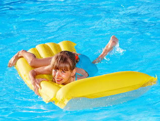 Child swimming inflatable beach mattress.