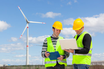 Two Engineers in a Wind Turbine Power Station