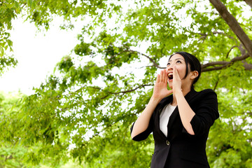 asian businesswoman cheering in the park
