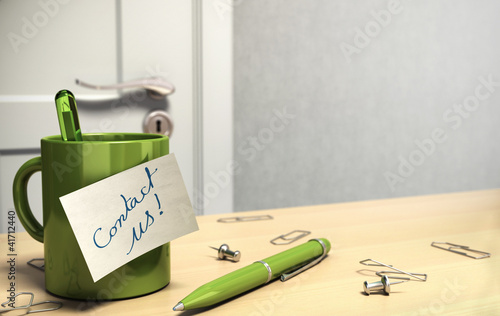 contact us text on note, office room, green design