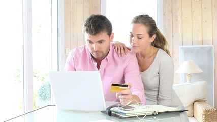 Couple shopping on internet at home