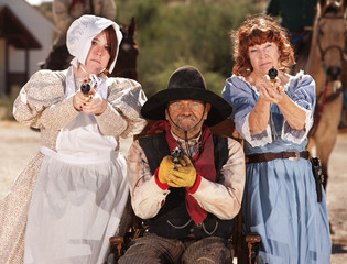 Armed Ladies and Cowboy in Wheelchair