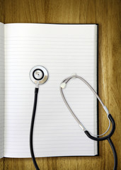 stethoscope on notepad