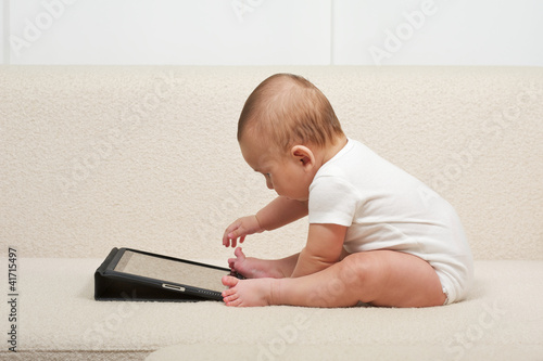 Baby with a small computer