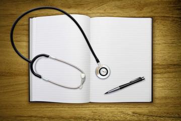 stethoscope open blank book