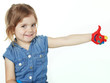 Little girl shows her coloured hand with thumb up