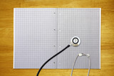 stethoscope on graph paper
