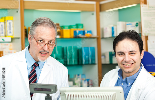 Portrait of two pharmacists in a store