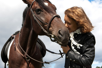 beautiful girl near a horse