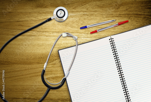 open work book and stethoscope