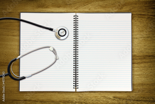 stethoscope on blank notepad