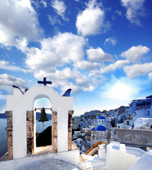 Famous Santorini with church bell in Oia village, Greece