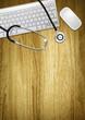 desktop computer and stethoscope