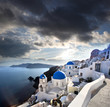 Santorini with dramatic sunset over Oia village, Greece