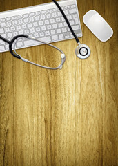 desktop computer and stethoscope