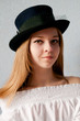 Beautiful girl in vintage hat