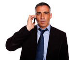 Senior executive broker listening on mobile poster
