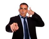 Hispanic senior broker pointing poster