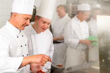 Professional kitchen chef cook add spice food