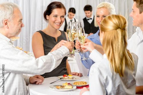 Leinwandbild Motiv Business partners toast champagne company event