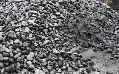 A Large Pile of Coal with a Shovel.
