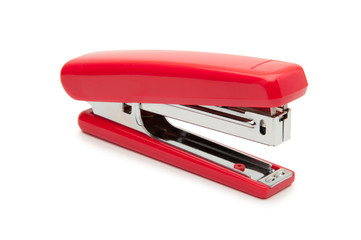 Red stapler on a white background.