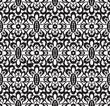 Seamless black lace pattern on white
