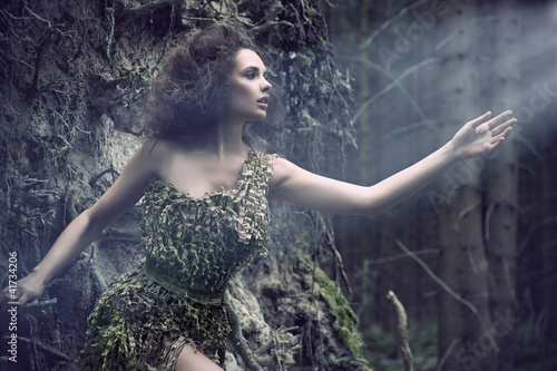 Beauty woman as a part of tree
