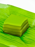 Khanom Chan (Thai layer sweetmeat) on banana leaf poster