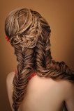 Fototapety Rear view of a beautiful woman with elegant elaborate hairstyle