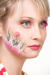 pretty blond woman with face art