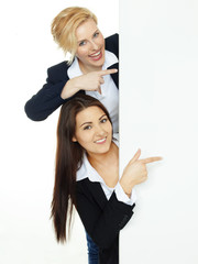 Pretty girls with white message board on white background