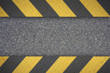 Yellow and black warning on the sidewalk.