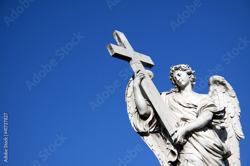 Angel with crucifix near Castel St. Angelo in Rome