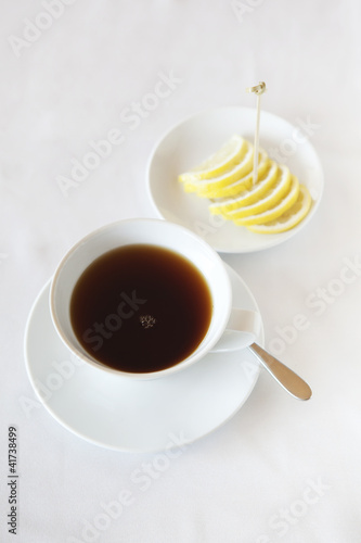 Tea cup and lemon