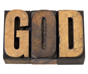 God - word in wood type